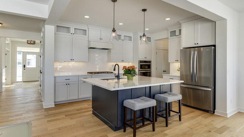 Modern white kitchen with pendant lighting