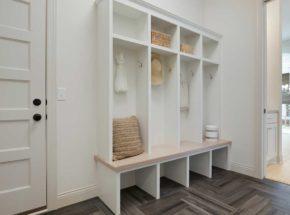 White cabinets in mudroom storage