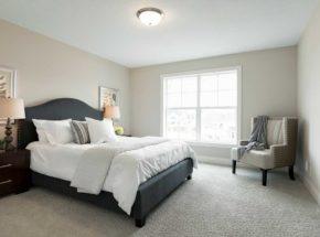 Modern bedroom with grey plush headboard