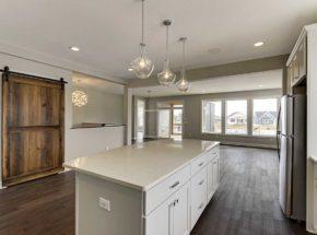 Center kitchen island with warm white countertop